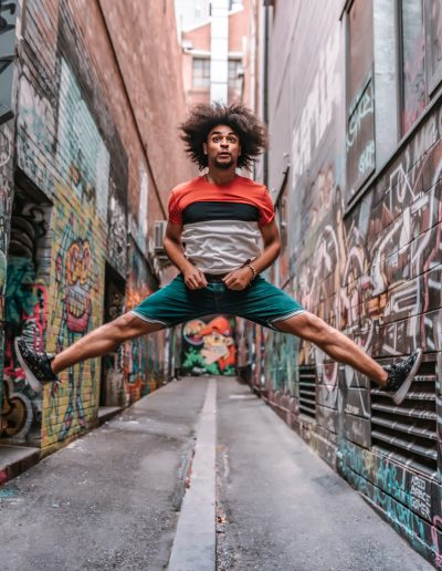 Afro hairstyle young male jumps in the air