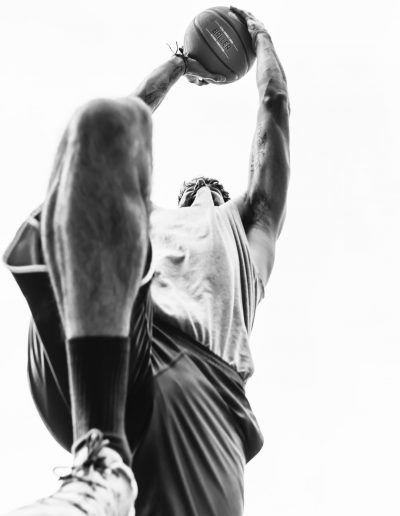 Black and white basketball player jump