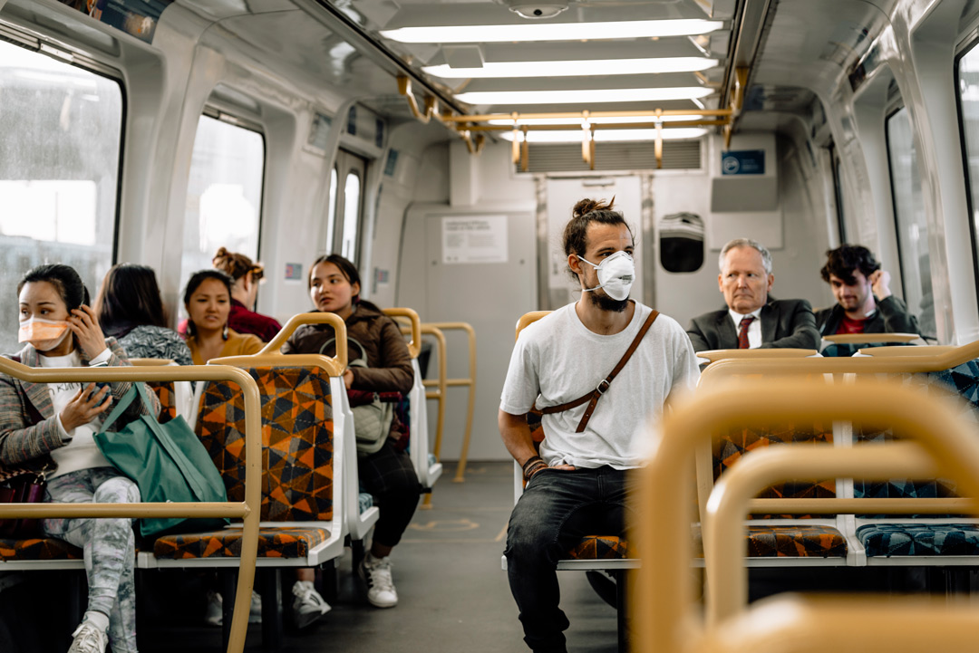 People with face mask in melbourne train