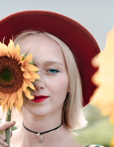 Blue eyed girl with sunflower
