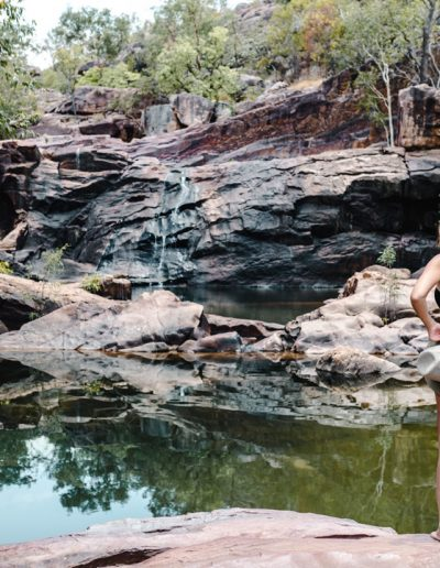 A young female in front of a natural pool in Kakadu, Australia