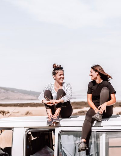 Two girl travelling on a van