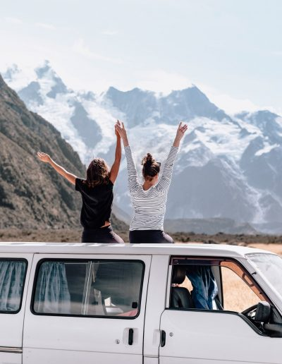 Two friends on top of a van